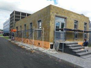 Как утепляют фасад дома сотрудники компании Квадрат