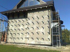 Как утепляют фасад стены сотрудники компании Квадрат